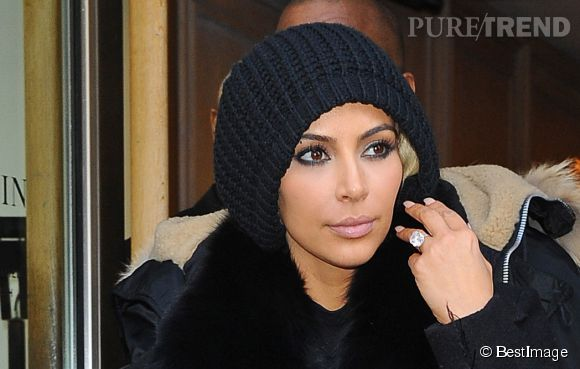 Kim Kardashian à la sortie de la boutique Lanvin à Paris, le 5 mars 2015 au matin. Elle cachait sa nouvelle tête.