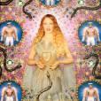 """""""La Vierge aux serpents"""" (Kylie Minogue) 2008. Photographie peinte, encadrée par les artistes. Modèles Auréole, robe longue en tulle plissée bleu céleste et lamé or appliqué en rayons, long pan au dos. Collection Les Vierges Haute Couture Printemps-Été 2007."""