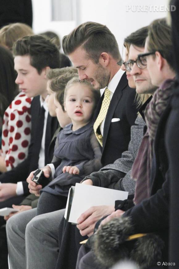 David Beckham et Harper sur le front row du défilé Victoria Beckham.