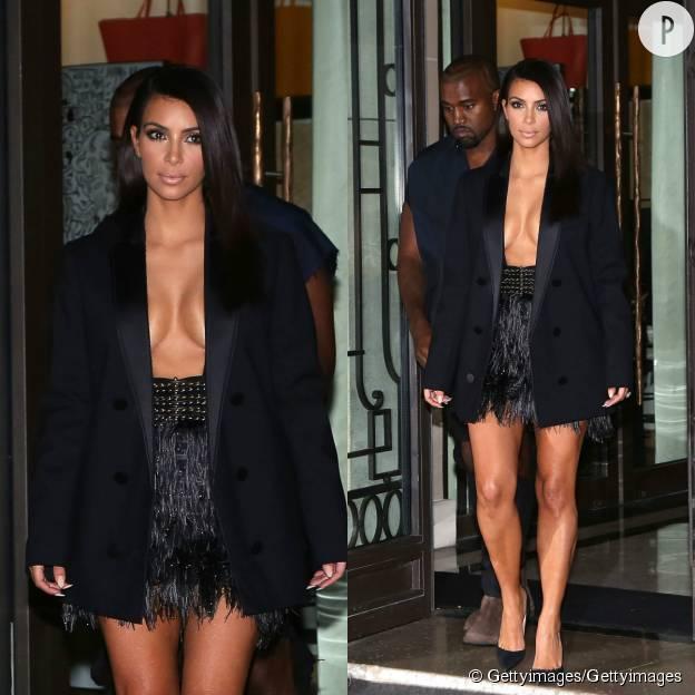 Kim Kardashian très très décolletée pour assister au défilé Lanvin Printemps-Été 2015.