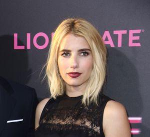 Aux côtés de Dave Franco, Emma Roberts portait une robe noire signée Elie Saab.