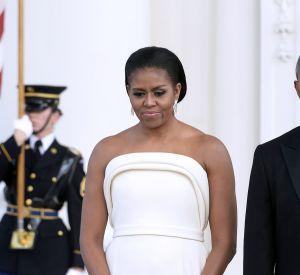 Une robe couleur ivoire pour Michelle Obama qui nous a habitués à plus de couleur et d'imprimés pour ses tenues.
