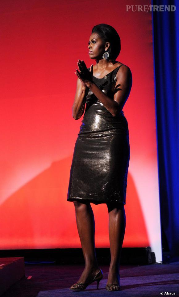 La First Lady en robe lamée.