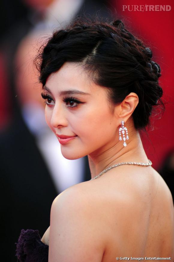 Cannes : les plus belles coiffures du dimanche 15 mai    Fan Bingbing mise sur un chignon tressé et place sa mèche sur le côté.