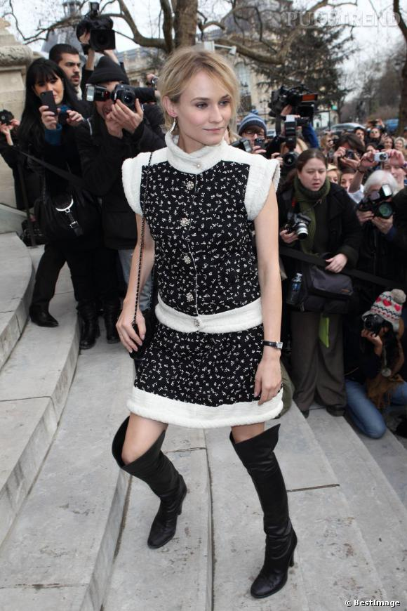 Diane Kruger opte pour une robe très girly associée à des cuissardes rock.