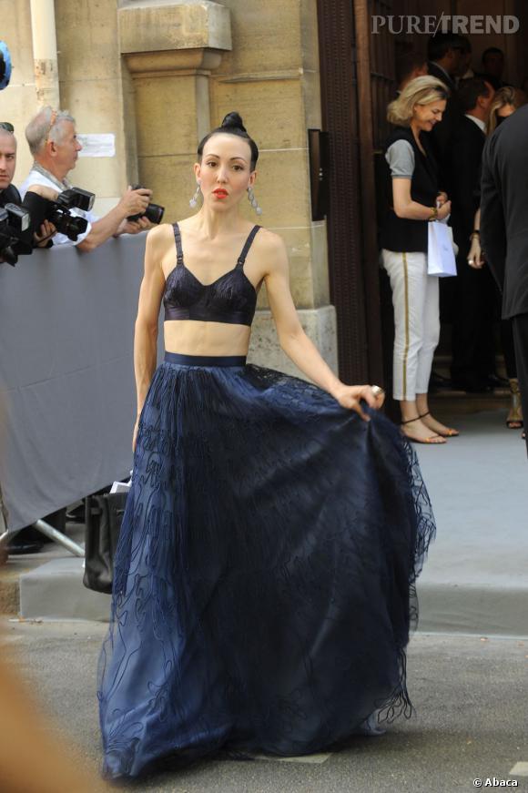 Michelle Harper sait comment se faire remarquer au défilé Dior.