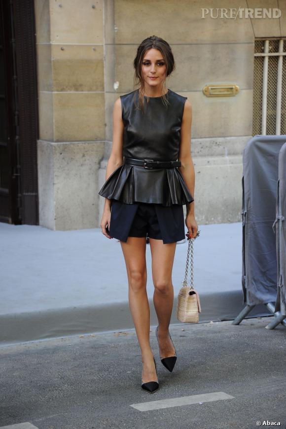 La jeune femme se montre attentive aux tendances et craque pour un top peplum en cuir issu de la collection Croisière 2013 Dior.