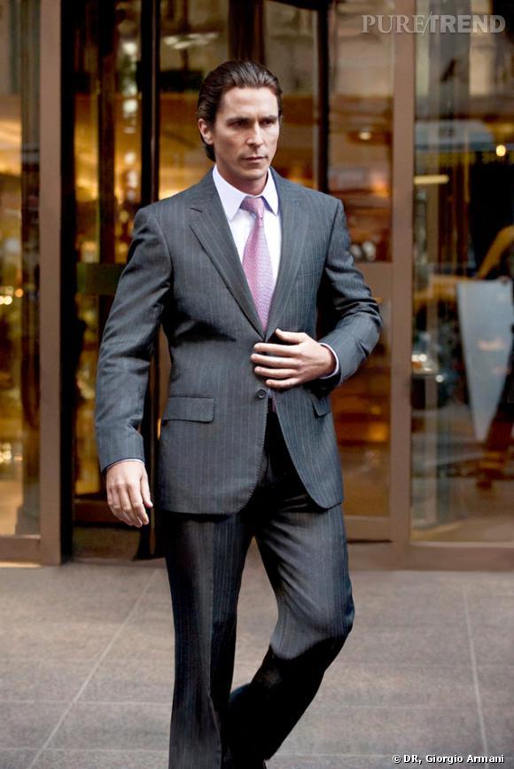 "Christian Bale alias Bruce Wayne habillé par Giorgio Armani dans ""The Dark Knight Rises""."