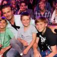 David Beckham et ses fils, parfaits pour une publicité.