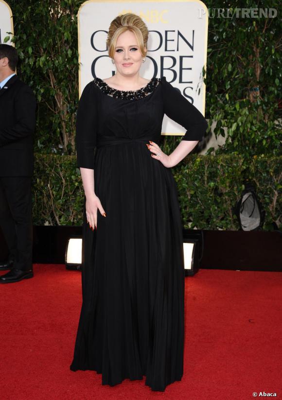 La styliste explique aussi qu'Adele porte toujours des gaines sous ses robes.