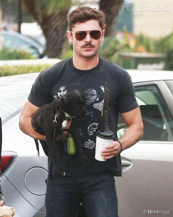 Zac Efron et son adorable boule de poils. On craque, malgré la moustache de monsieur.