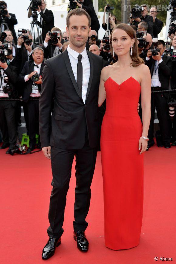 Nathalie Portman en robe Dior et sa parure de bijoux de Grisogono, en compagnie de son mari Benjamin Millepied.