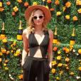 Diane Kruger sexy pour Veuve Clicquot dans une combinaison géométrique vintage signée Rolans Mouret, samedi 30 mai 2015.