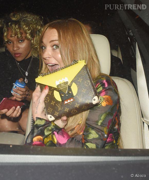Lindsay Lohan affiche une mine rayonnante à la soirée Louis Vuitton à Londres.