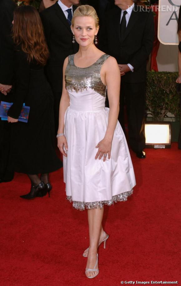 La belle ose désormais les robes très ajustées et les détails glitter. La crinière relevée, elle est divine.