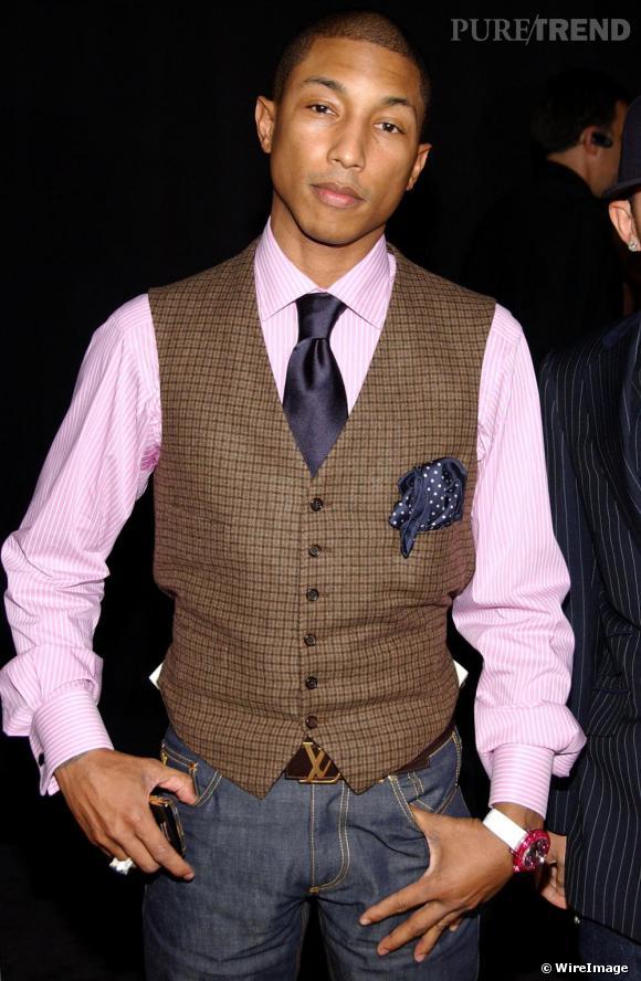 Les hommes ne sont pas épargnés et le rappeur Pharrell Williams succombe à la boucle dorée Louis Vuitton.