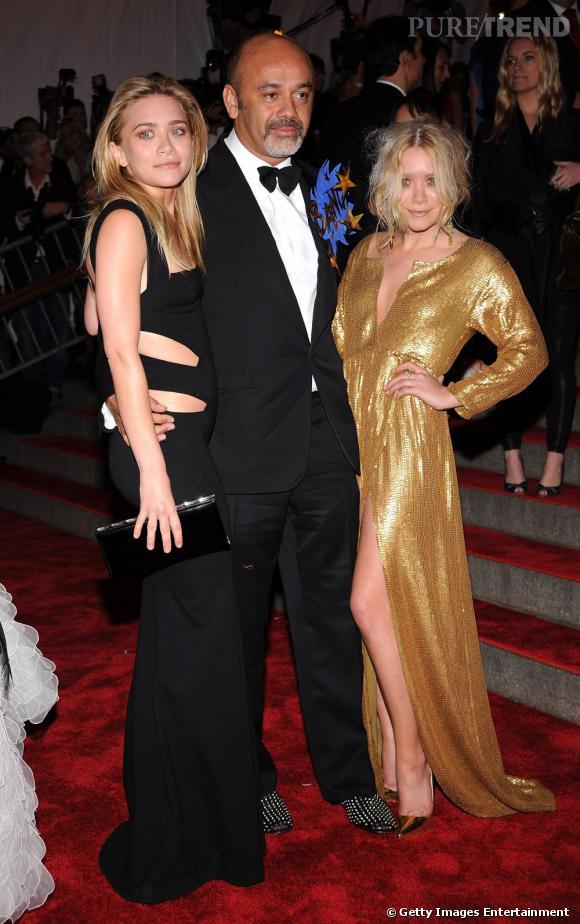 Christian Louboutin bien entouré aux côtés des soeurs Olsen.