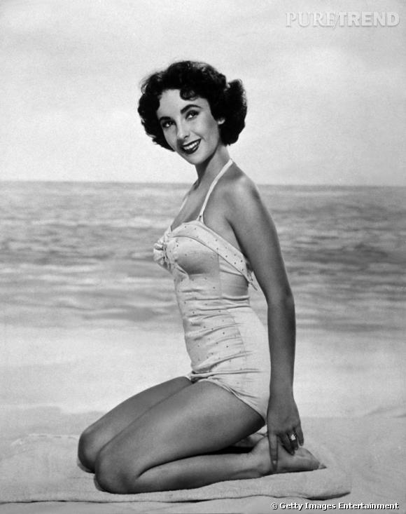 e49c249528 Elizabeth Taylor pose en maillot de bain une-pièce gainant dans les années  40.
