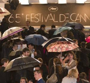 L'insolite de Cannes : la pluie, star du tapis rouge
