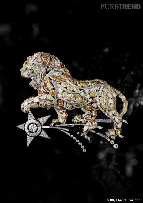 """Chanel Joaillerie.  Broche """"Constellation du Lion"""" en or blanc, diamants blancs, jaunes et oranges."""