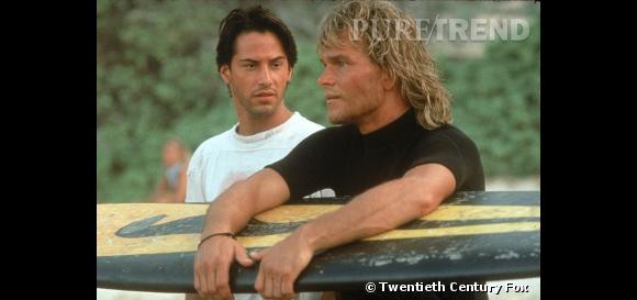 """Comment oublier les cheveux blonds et wavy de Patrick Swayze dans """"Point Break"""". Avec sa chevelure comme délavée par le soleil et l'eau salée, il incarnait à merveille l'image du surfeur californien."""