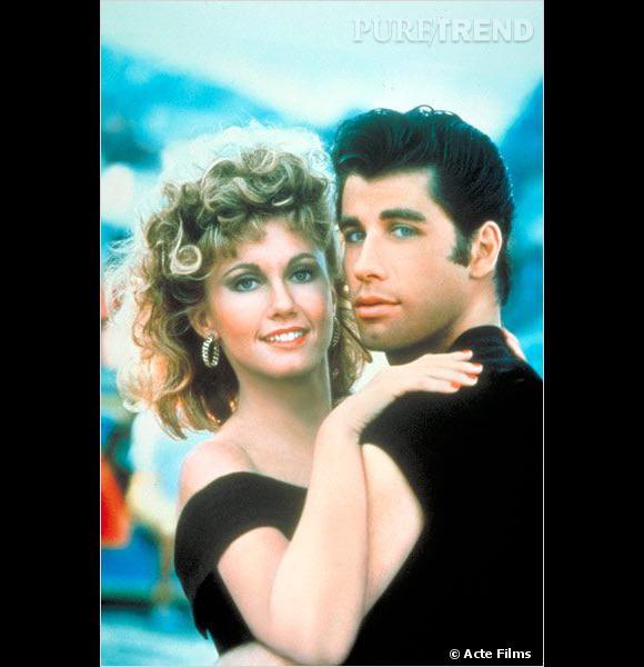 """Film culte, """"Grease"""" fait la part belle à la banane rock'n'roll (pour John Travolta) et à la crinière frisée (pour Olivia Newton-John)"""