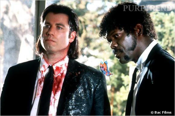 """Film culte de Quentin Tarantino, """"Pulp Fiction"""" a ancré des coiffures dans notre mémoire collective. Notamment la coupe aux épaules de John Travolta et la chevelure frisée de Samuel L. Jackson."""