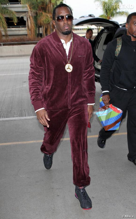Diddy joue les grains de raisin avec un total look un peu has been.