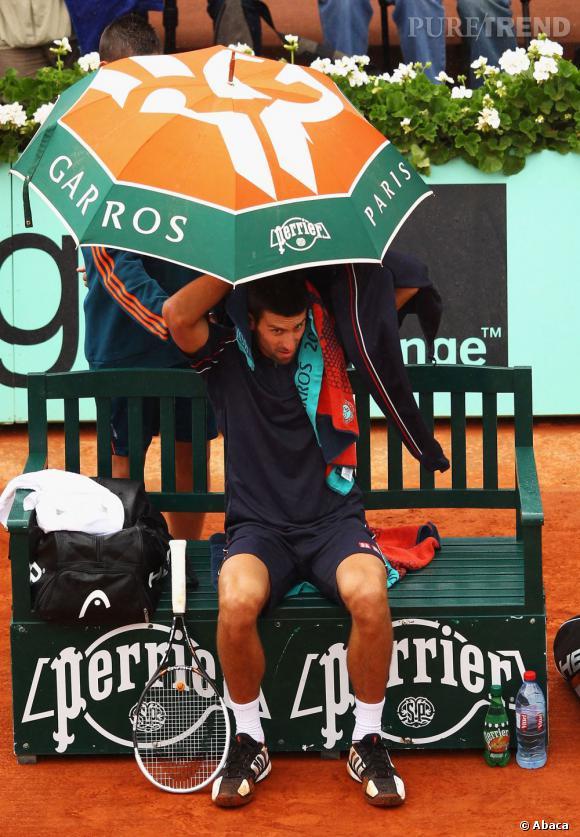 Novak Djokovic s'opposait à Rafaël Nadal sous la pluie.