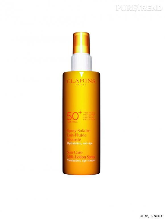Spray Solaire Lait-Fluide Sécurité UVA/UVB 50+ Clarins, prix : 26,70 euros.