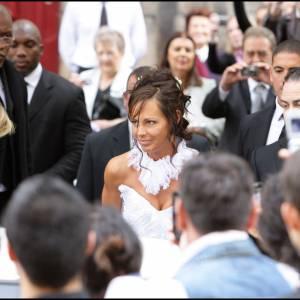 Nathalie Marquay était habilée d'une robe immaculée signée Hervé Leroux.