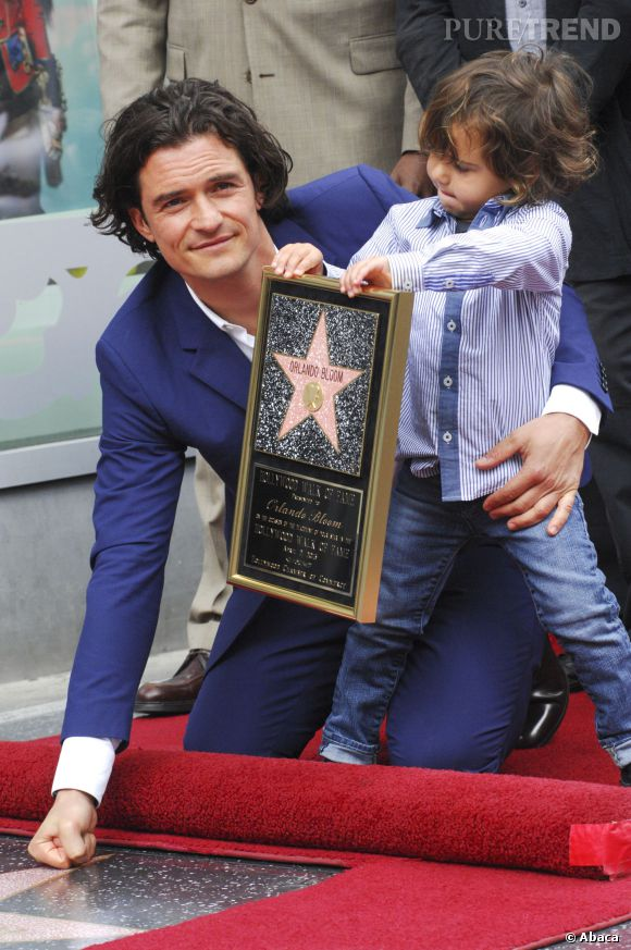 Orlando Bloom et son fils Flynn lors de l'inauguration de l'étoile de l'acteur, sur le Hollywood Walk of Fame.