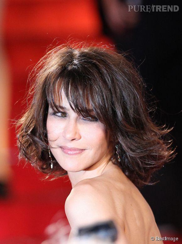 Sophie Marceau sait séduire l'objectif des photographes du palais des festivals à Cannes, mardi 20 mai 2014.