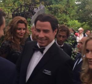 L'arrivée de John Travolta à la soirée Puerto Azul à Cannes le 21 mai 2014.
