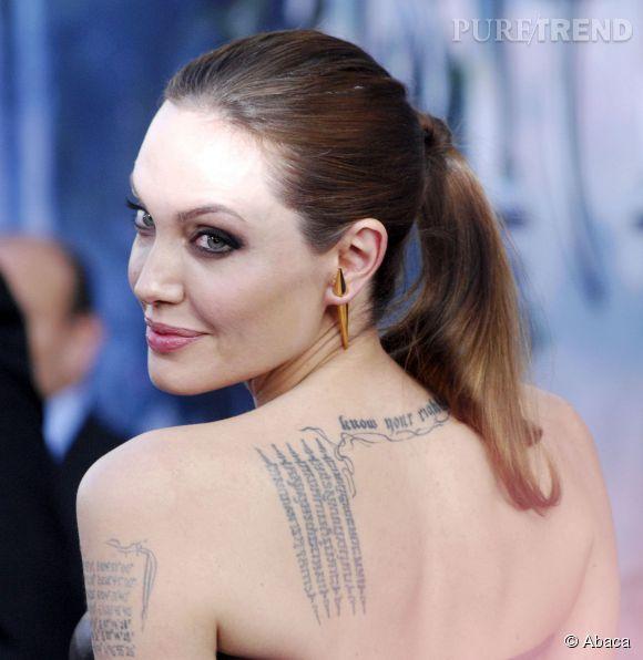 """Angelina Jolie à la première de """"Maléfique"""" à Los Angeles le 28 mai 2014 loin de se douter ce que trame le journal """" The National Enquirer""""."""