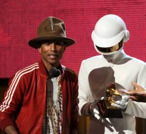 Pharrell Williams et les Daft Punk lors de la cérémonie des Grammy Awards en janvier 2014.