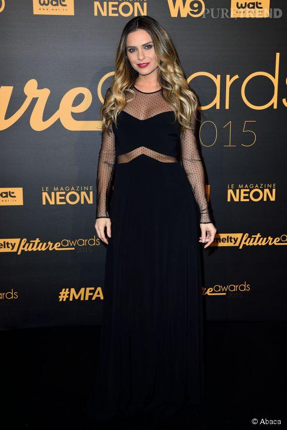 Clara Morgane aux Melty Future Awards mercredi soir. La jolie blonde a opté pour une robe noire à la transparence sexy.