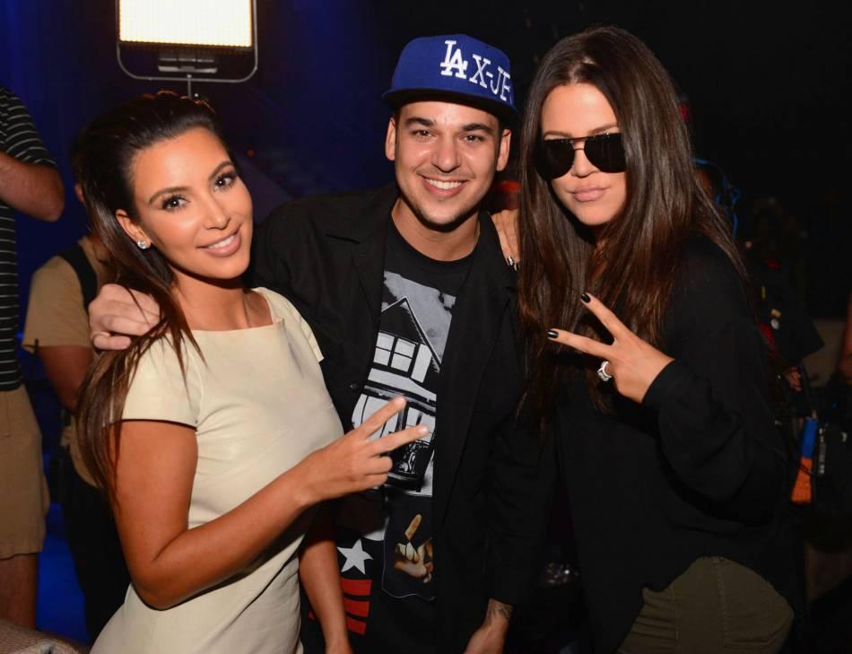 Rob Kardashian aux côtés de Kim et Khloe en 2012.