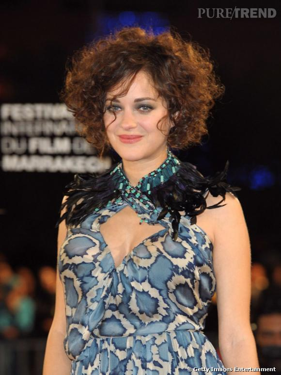 Les coiffures de Marion Cotillard    Une cascade de boucle dont on est moins fan...