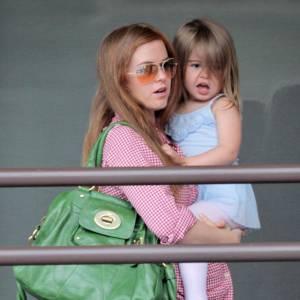Pour s'harmoniser avec sa couleur de cheveux, Isla Fisher mise sur le Kira en vert.