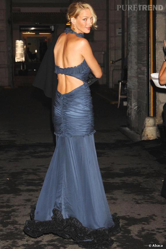 Uma Thurman n'attend pas encore le sans-faute en matière de pose mais elle fait son petit effet.