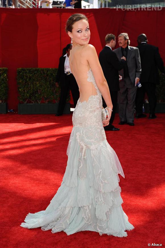 Avec une robe trompe-l'oeil, Olivia Wilde est tout simplement renversante. Son regard félin et sa pose maîtrisée ne lui enlèvent rien.