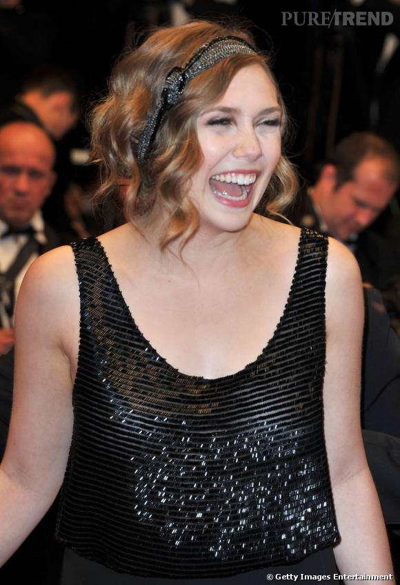"""Elizabeth Olsen monte les marches à Cannes pour le film """"Martha Marcy May Marlene""""."""