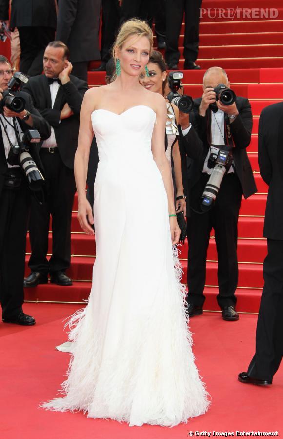 Pour la cérémonie d'ouverture, Uma Thurman était également en robe blanche, mais cette fois-ci signée Versace.