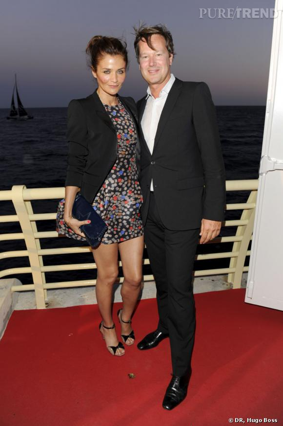Helena Christensen lors de la soirée Hugo Boss et McLaren à Monaco aux côtés du directeur de la communication d'Hugo Boss, Philipp Wolff.