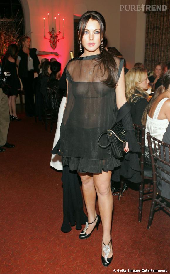 Brunette in seethrough dress spreads her legs 3