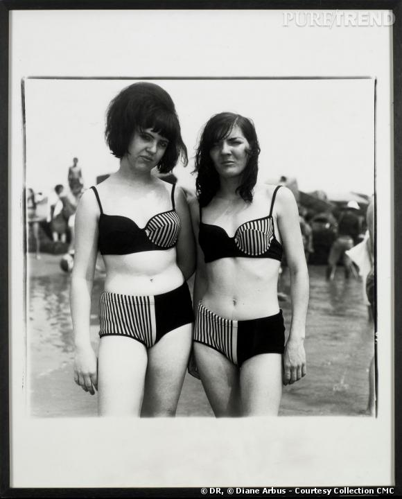 Two girls in matching bathing sits. Coney Island, NY, 1967.