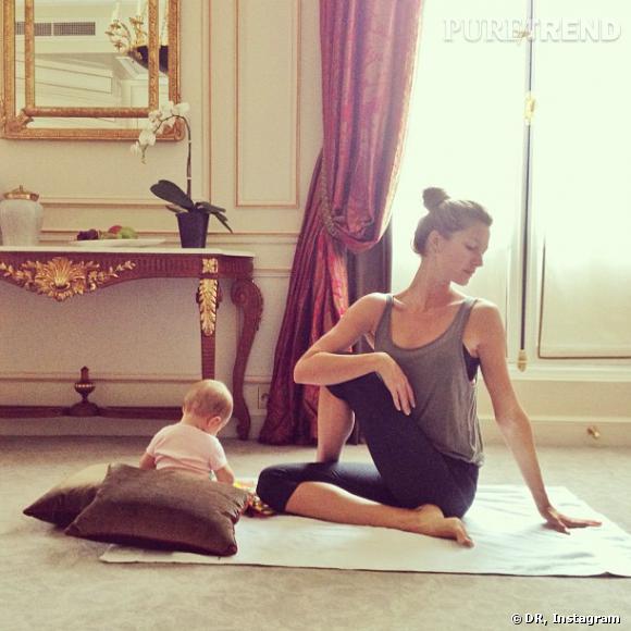 Gisèle Bundchen profite de la compagnie de son bébé, même pendant sa séance de yoga.