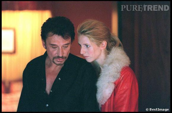 "Johnny Hallyday et Sandrine Kiberlain sur le tournage du film ""Love Me"" en 1999."