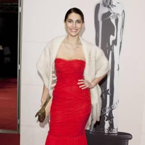 Caterina Murino, sensuelle dans sa robe rouge en 2009.
